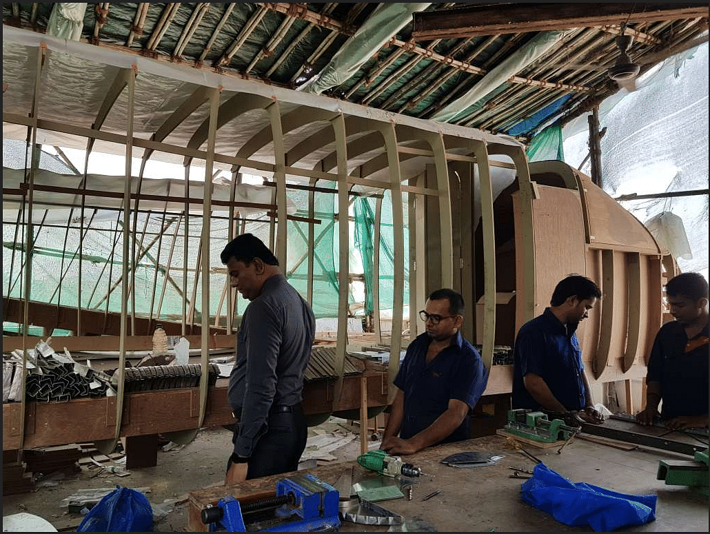 Workers working to build 19 seater plane on rooftop of Amol Yadav's building in Charkop, Mumbai.