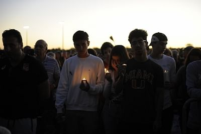 PARKLAND, Feb. 16, 2018 (Xinhua) -- People hold candles during a vigil for the victims of the shooting at Marjory Stoneman Douglas High School, in Parkland, Florida, the United States, Feb. 15, 2018. Seventeen people were killed in a mass shooting in a high school in Florida in the United States Wednesday, local police said. (Xinhua/Liu Yang/IANS)
