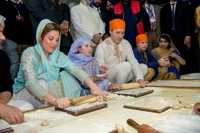 Amritsar: Canadian Prime Minister Justin Trudeau along with his wife Sophie Gregoire Trudeau and children help in preparing Guru Ka Langar during their visit to the Golden Temple in Amritsar on Feb 21, 2018. (Photo: IANS)