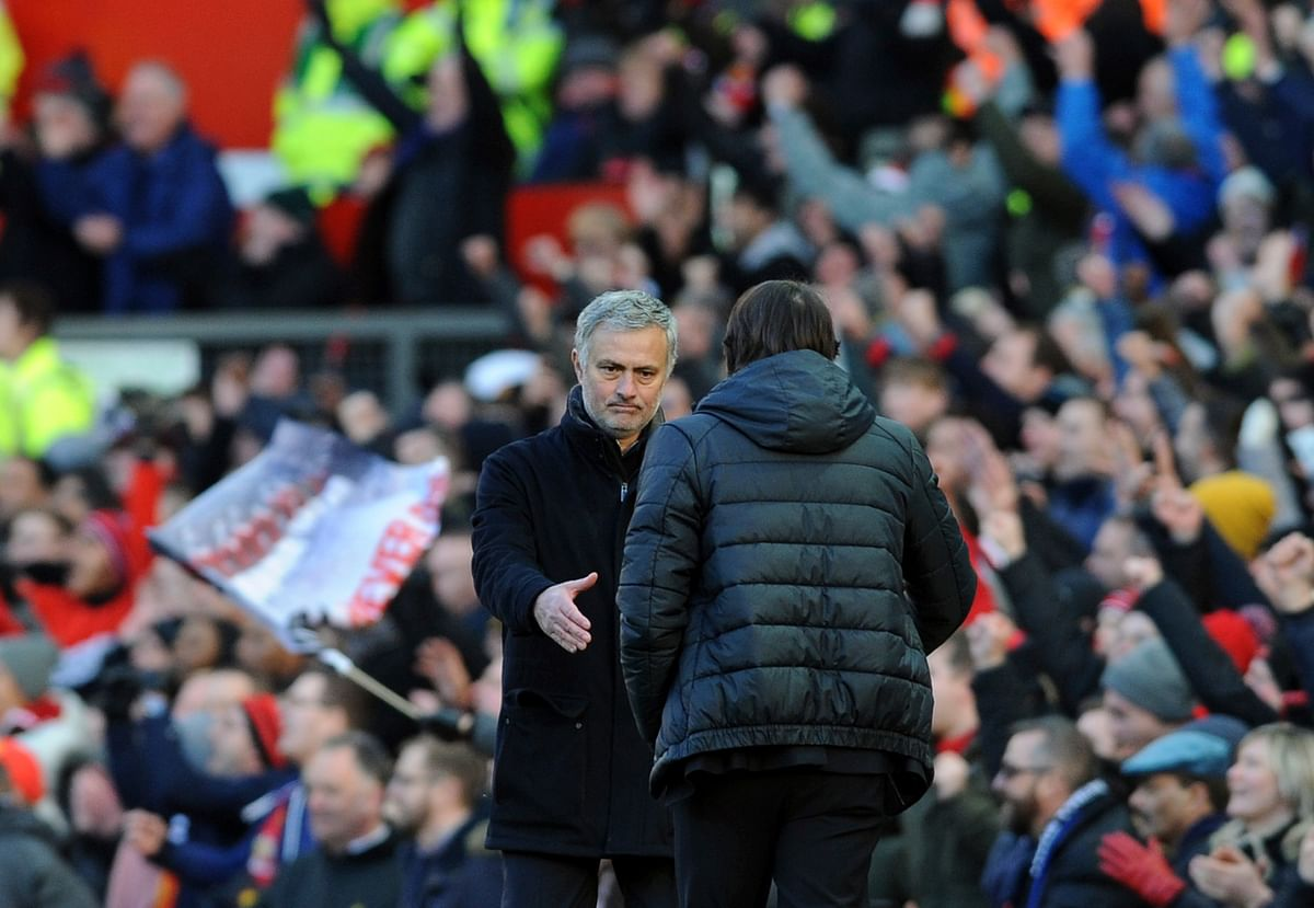 Manchester United's manager Jose Mourinho (left) shakes hands with Chelsea's team manager Antonio Conte at the end of the match.