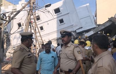 Bengaluru: Rescue operation underway after a four-storey building under construction collapsed on Jail Road at Kasavanahalli in Bengaluru on Feb 15, 2018. Reportedly three labourers were died and seven injured. (Photo: IANS)