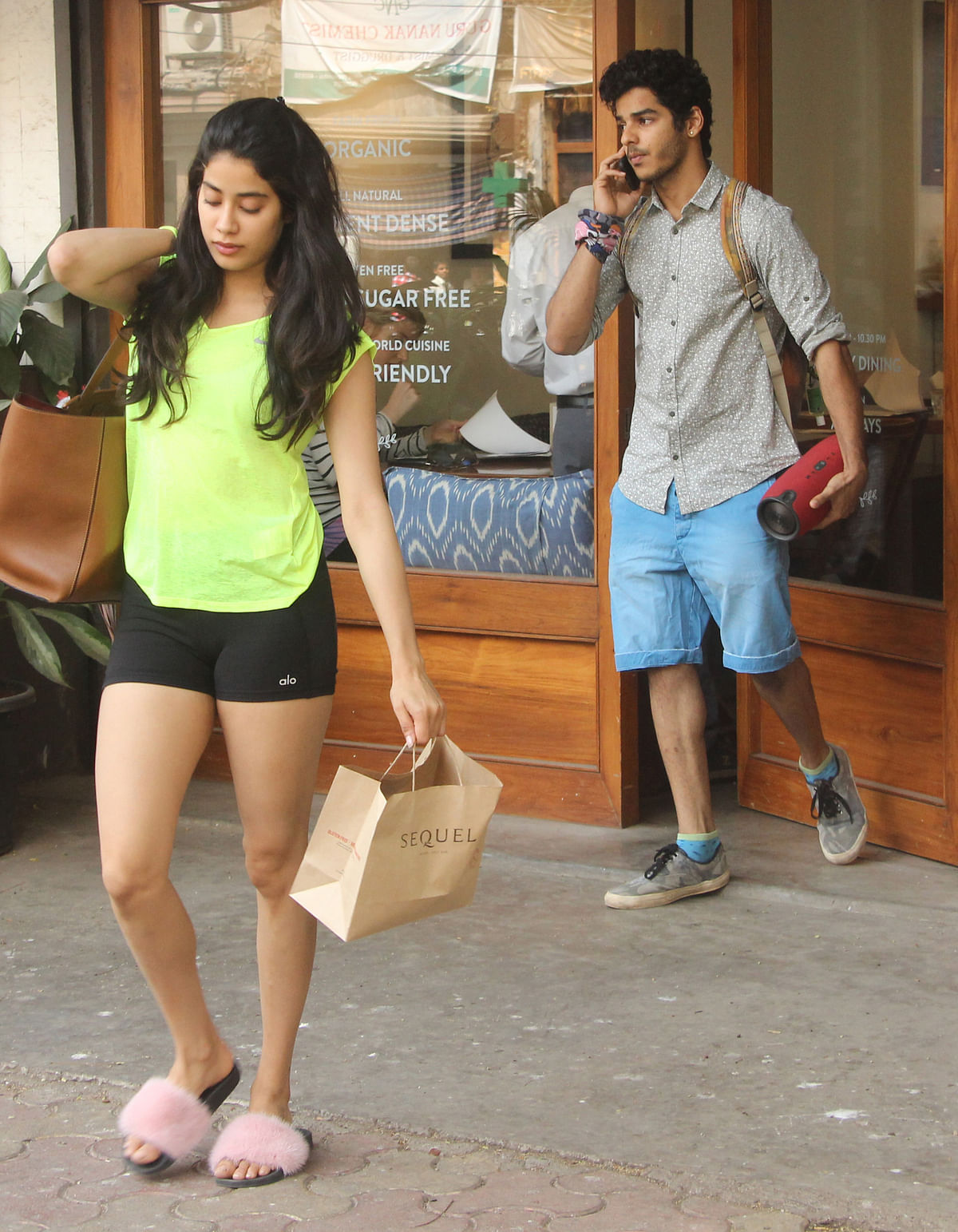 Janhvi Kapoor and Ishaan walk out of a health cafe.