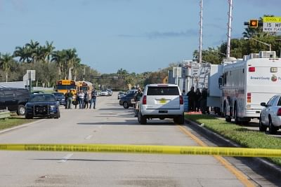 The site of a mass shooting near Marjory Stoneman Douglas High School is sealed off in Parkland, Broward County, Florida, the United States, on Feb. 15, 2018. 17 people were killed and over a dozen others were wounded after a 19-year-old gunman opened fire Wednesday at the high school, authorities said. (File Photo: Xinhua/Monica McGivern/IANS)