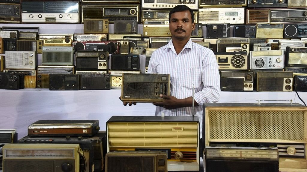 Rajendra Sahu displays one of his radios from his vintage collection.
