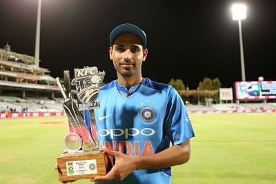 Cape Town: Bhuvneshwar Kumar of India poses with the Man of the Series trophy during post match presentation ceremony at the Newlands Cricket Ground in Cape Town, South Africa on Feb 24, 2018. (Photo: BCCI/IANS) (Credit Mandatory)