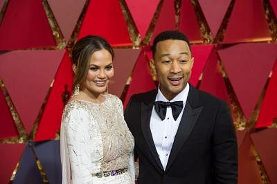 LOS ANGELES, Feb. 27, 2017 (Xinhua) -- Singer John Legend (R) and his wife U.S. model Chrissy Teigen arrive for the red carpet of the 89th Academy Awards at the Dolby Theater in Los Angeles, the United States, on Feb. 26, 2017. (Xinhua/Yang Lei)(gj/IANS)