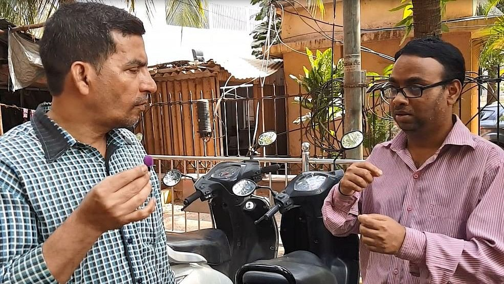 Madhukar Yogi (right) takes the help of a colleague to explain his worries about being unemployed.