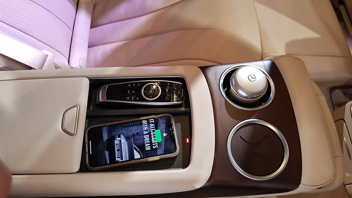 The centre armrest has wireless phone charging capability.