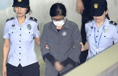 Seoul: Choi Soon-sil(C) arrives at the Seoul Central District Court, South Korea, on June 23, 2017. Choi Soon-sil, a close confidante of impeached South Korean President Park Geun-hye, on Friday got a three-year prison term for one of her corruption charges involving her daughter. (Xinhua/Newsis/IANS)