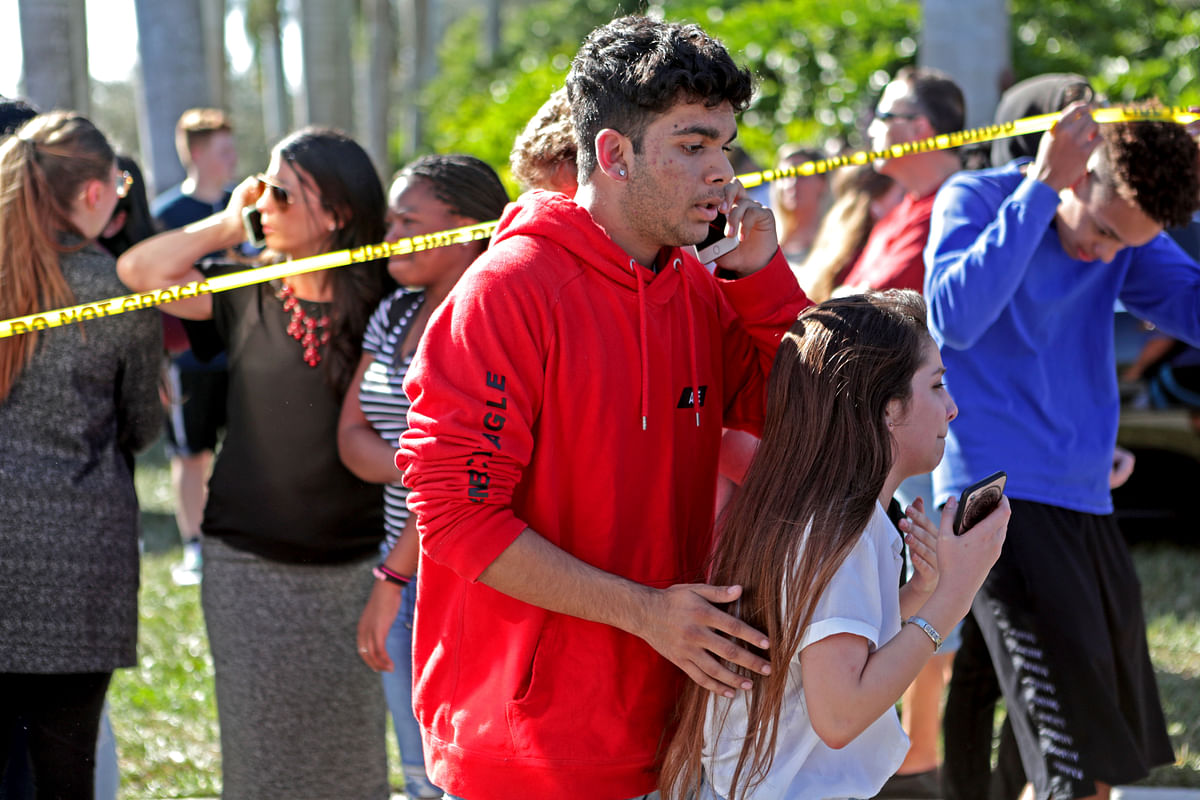 Students released from a lockdown are overcome with emotion following following a shooting at Marjory Stoneman Douglas High School in Florida on 14 February 2018.