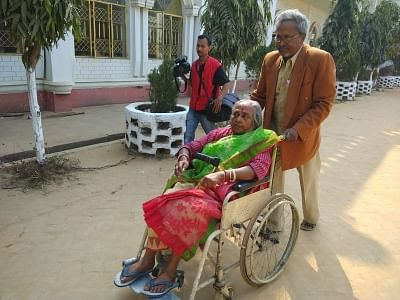 Agartala: A man assists an elderly woman to a polling booth as they proceed to cast their votes during Tripura Assembly elections in Agartala on Feb 18, 2018. (Photo: IANS)