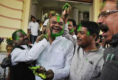 Patna: RJD workers celebrate after the party won the Jehanabad Assembly seat and established a winning lead in the Araria Lok Sabha seat in Bihar, in Patna on March 14, 2018. (Photo: IANS)