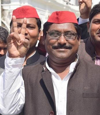 Allahabad: Samajwadi Party candidate Nagendra Singh Patel shows victory sign after being elected to the Lok Sabha from Phulpur, in Allahabad on March 14, 2018. According to the Election Commission, he defeated his nearest BJP opponent by 59,613 votes. (Photo: IANS)