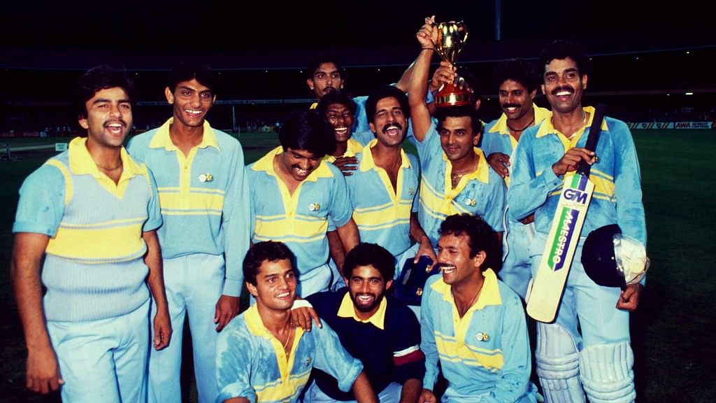 The Indian team celebrate after winning the final of the World Championship of Cricket in 1985.