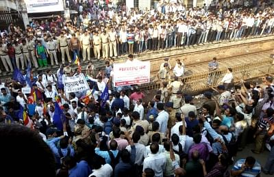 Mumbai: Protestors disrupt railway services during a Maharashtra shutdown called by various Dalit parties against Koregaon-Bhima (Maharashtra) violence, in  Mumbai on Jan 3, 2018. Violence erupted in Koregaon-Bhima village on January 1 during the 200th-anniversary celebrations of the Anglo-Maratha War between the army of Peshwa Bajirao II with a small force of the East India Company that comprised a large number of Dalits. Maharashtra Chief Minister Devendra Fadnavis on Tuesday announced a probe