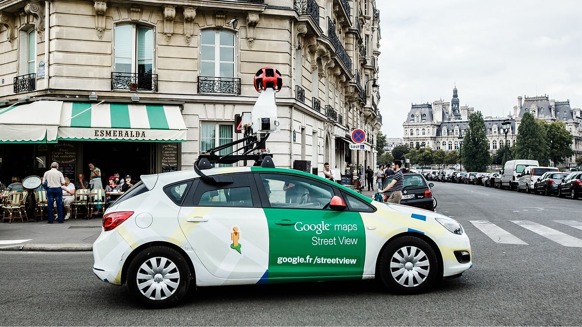 A Google Street View car on the streets of Paris. It uses a camera rig comprising of 9 directional cameras for a 360 degree view of the world around it.