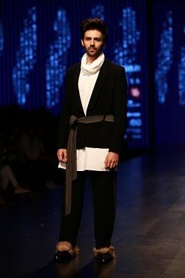 New Delhi: Actor Kartik Aaryan the ramp showcasing fashion designer Pawan Sachdeva