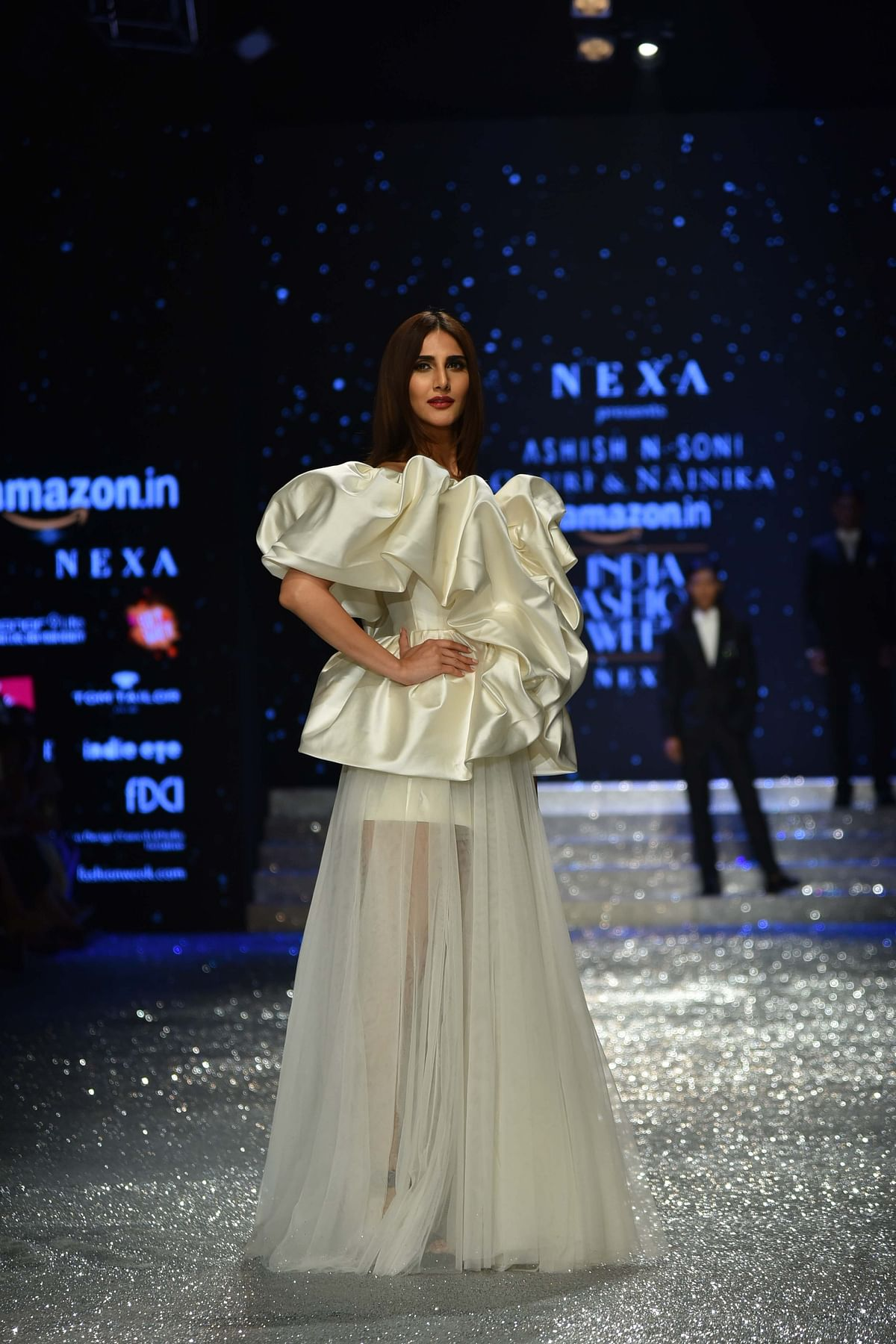 Vaani Kapoor looks like a vision in white as she dons a sheer outfit with ruffles designed by Gauri and Nainika.