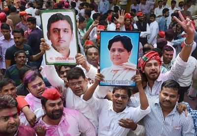 Lucknow: Samajwadi Party (SP) and Bahujan Samaj Party (BSP) workers celebrate, outside SP office in Lucknow on March 14, 2018. SP on Wednesday took winning leads in both the Lok Sabha seats of Gorakhpur and Phulpur. With BSP backing its bitter rival SP, BJP appeared to be heading for a shock defeat. (Photo: IANS)
