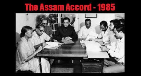 Rajiv Gandhi signing the Assam Accord.