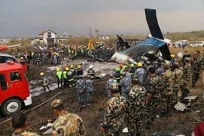 KATHMANDU, March 12, 2018 (Xinhua) -- Rescuers work at the plane crash site in Kathmandu, Nepal, on March 12, 2018. At least 49 people were killed and 17 injured after a passenger plane of the US-Bangla Airlines crashed at Nepal
