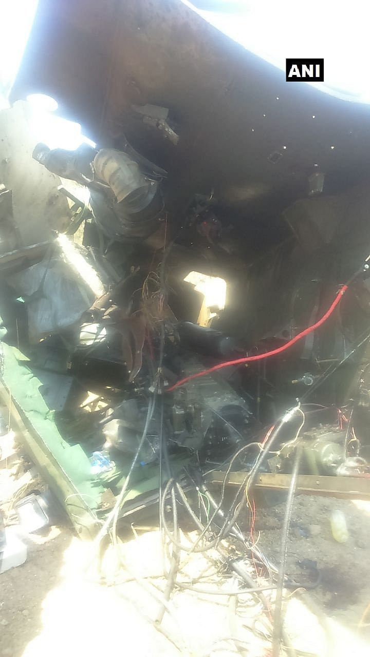 A photo of the charred remains of the CRPF vehicle.