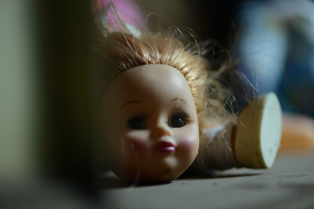 A broken doll's head.