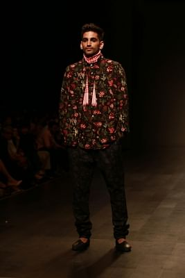 New Delhi: A model showcases creations of fashion designer duo David Abraham and Rakesh Thakore during Amazon India Fashion Week in New Delhi, on March 14, 2018. (Photo: Amlan Paliwal/IANS)
