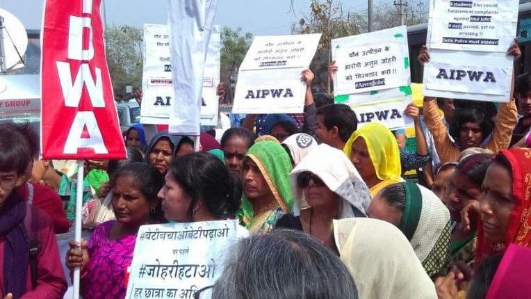 All India Progressive Women's Association (AIPWA) staged a protest and submitted a memorandum to Vasant Kunj police station over alleged molestation against a JNU professor.