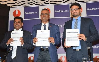 Kolkata: Bandhan Bank MD and CEO Chandra Shekhar Ghosh, CFO Sunil Samdani and Sunil Amin of Kotak Mahindra Capital during a press conference prior to launch of  banks
