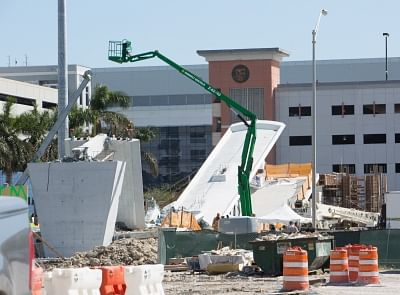 "MIAMI, March 15, 2018 (Xinhua) -- Photo taken on March 15, 2018 shows part of the collapsed footbridge in Miami, Florida, the United States, March 15, 2018. A pedestrian footbridge near Florida International University (FIU) collapsed Thursday afternoon, causing ""several fatalities,"" local authorities said. (Xinhua/Monica McGivern/IANS)"