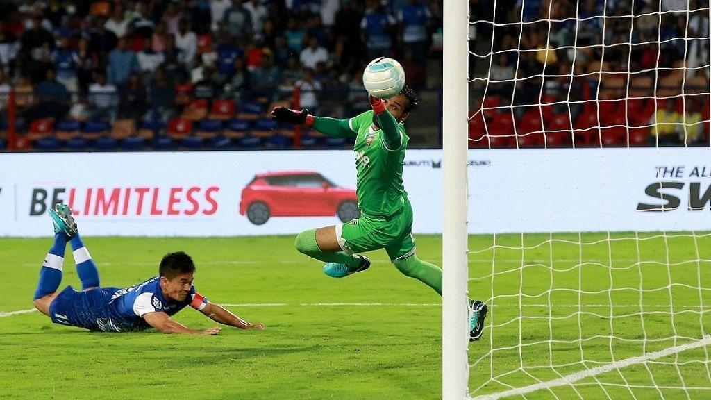 Sunil Chhetri of Bengaluru FC dives to score the opening goal against Chennaiyin FC in the ISL-4 final at Sree Kanteerava Stadium on Saturday