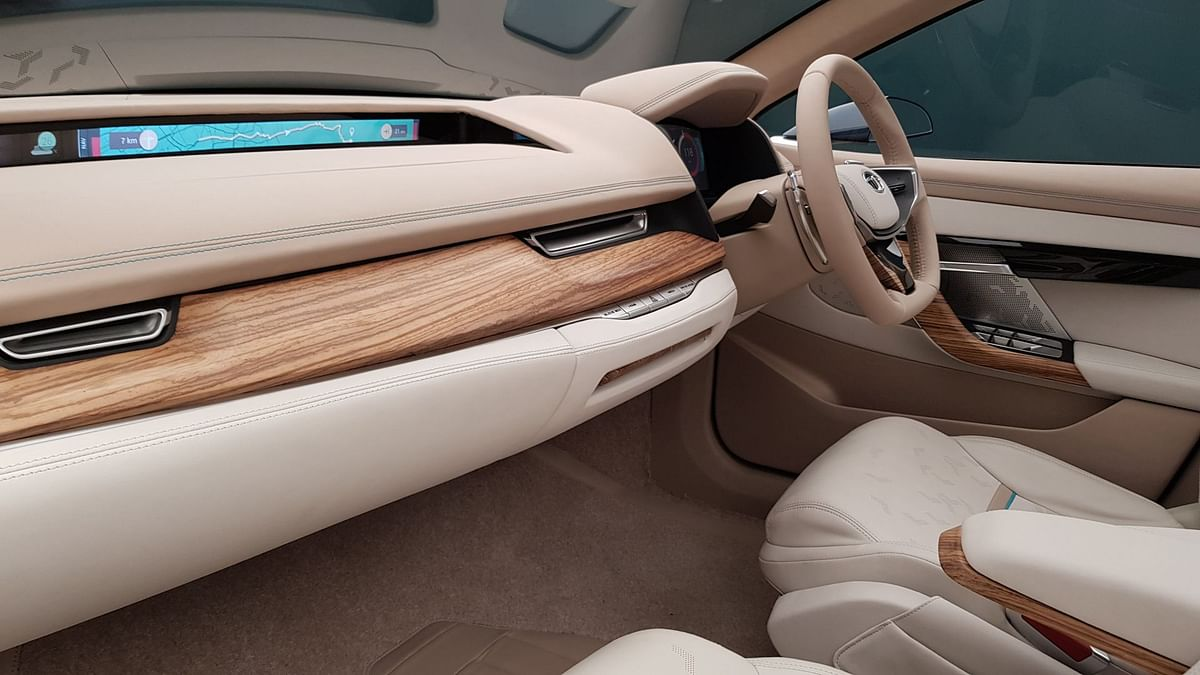 The wood and leather finish looks premium on the interiors. Notice the LCD display for passengers.