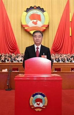 BEIJING, March 14, 2018 (Xinhua) -- Wang Yang casts his ballot at the fourth plenary meeting of the first session of the 13th National Committee of the Chinese People