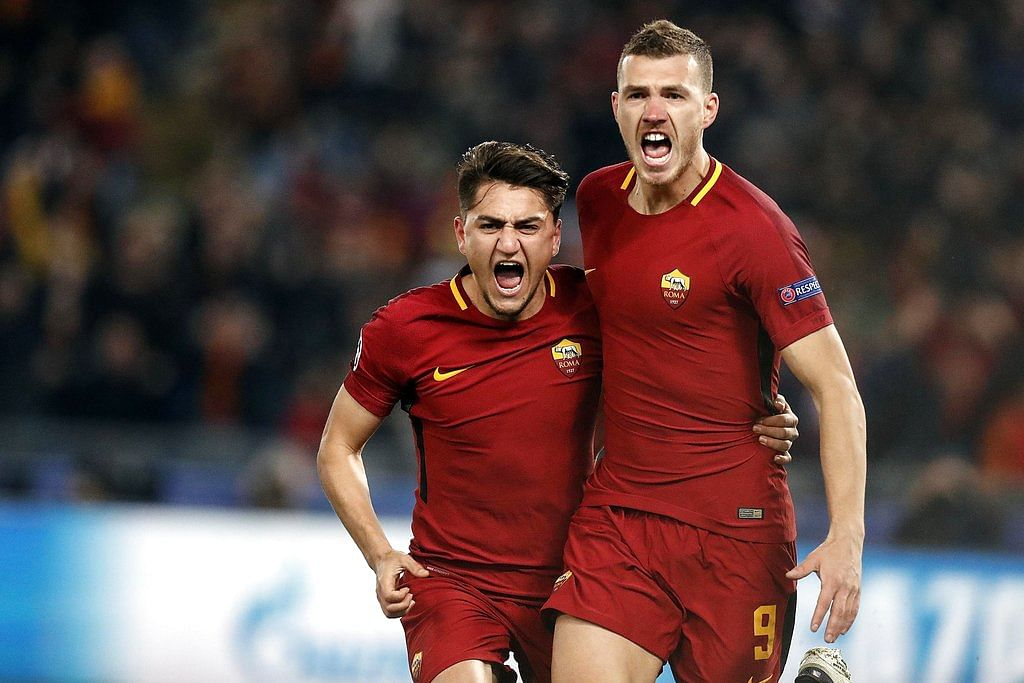 Roma's Edin Dzeko, right, celebrates with his teammate Cengiz Under after scoring against Shakhtar Donetsk.