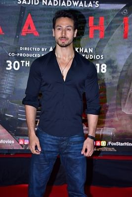 "Mumbai: Actor Tiger Shroff during the special screening of film ""Baaghi 2"" on March 29, 2018. (Photo: IANS)"