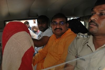 Sambalpur: BJP leader and former Odisha Minister Jayanarayan Mishra being taken away after the police arrested him in connection with a firing incident in which a Biju Janata Dal worker had died in Bargarh district; in Odisha
