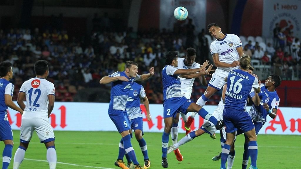 Mailson Alves of Chennaiyin FC heads to score the equaliser against Bengaluru FC in the ISL-4 final at Sree Kanteerava Stadium on Saturday