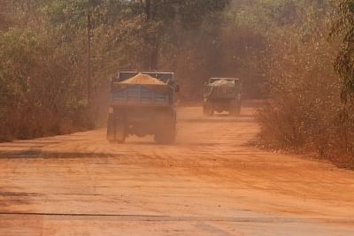 Navelim: Mining trucks usher dust pollution while on their way to mine fields near an iron plant at Navelim in Goa on March 13, 2018. BJP Goa MPs met the party