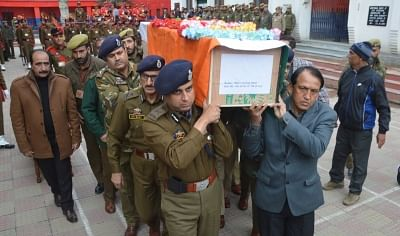 Srinagar: Kashmir IGP Swayam Prakash Pani along with others carries the coffin of SGCt Kultar Singh who attained martyrdom in a militant attack; in Srinagar on Feb 25, 2018. (Photo: IANS)