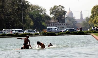 Children beat the heat on a hot day. (File Photo: IANS)