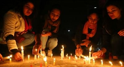 KATHMANDU, March 14, 2018 (Xinhua) -- Nepalese students participate in a candlelight vigil to pay respect to people killed in US-Bangla plane crash in Kathmandu, March 13, 2018. At least 49 people were killed and 22 injured after a passenger plane of the US-Bangla Airlines crashed at Nepal