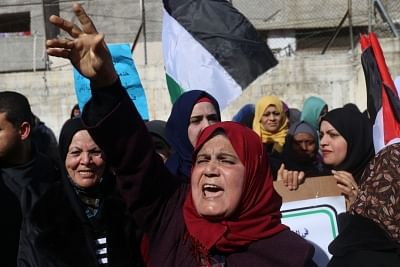 GAZA, Jan. 21, 2018 (Xinhua) -- Palestinian refugees protest in front of a United Nations Relief and Works Agency for Palestine Refugees (UNRWA) distribution center in the southern Gaza Strip city of Rafah, on Jan. 21, 2018. The UNRWA will launch on Monday a funding campaign to face its budget deficit, a UNRWA official said on Sunday. (Xinhua/Khaled Omar/IANS)