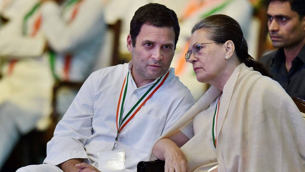 UPA chairperson Sonia Gandhi and Congress President Rahul Gandhi talk during the 84th Plenary Session of Indian National Congress in New Delhi on 17 March.