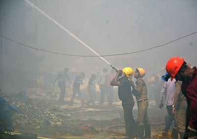 Kolkata: Firefighters douse a fire that broke out at a chemical warehouse in Armenian Ghat area of Kolkata, on March 15, 2018. (Photo: Kuntal Chakrabarty/IANS)