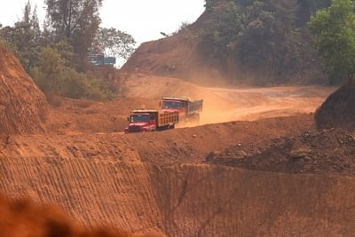 Navelim: A view of trucks moving amid mine fields near an iron plant at Navelim in Goa on March 13, 2018. BJP Goa MPs met the party