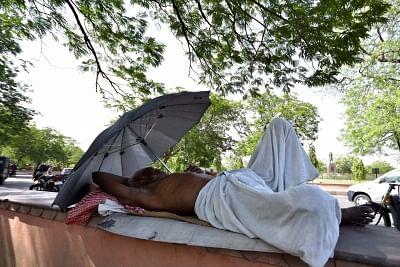 Jaipur: A man enjoys his siesta on a hot day in Jaipur on June 5, 2017. (Photo: Ravi Shankar Vyas/IANS)