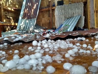 Hailstones damages rooftops at Riangdo village in Meghalaya's West Khasi Hills district on  Friday.