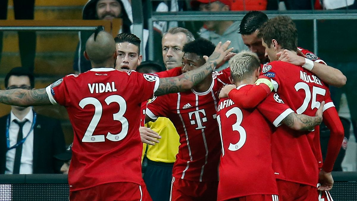 Bayern's players celebrate the third goal of their team during the Champions League, round of 16, second leg, soccer match between Besiktas and Bayern Munich at Vodafone Arena stadium in Istanbul, Wednesday, March 14, 2018. Bayern won 3-1.