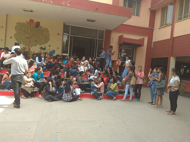 Students from Kamla Nehru College take part in the dharna organised by DUTA